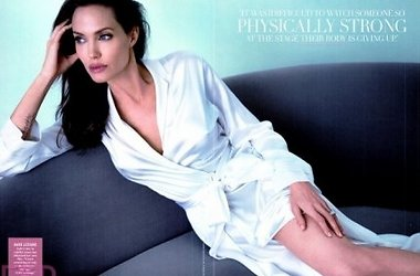 Angelina Jolie shows her tattoo in new photo shoot