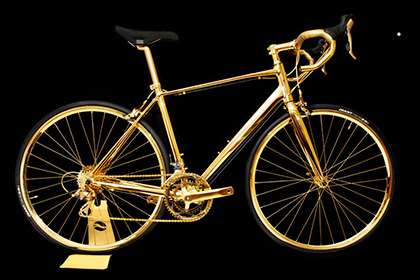 Golden bicycle with diamonds for luxury lovers