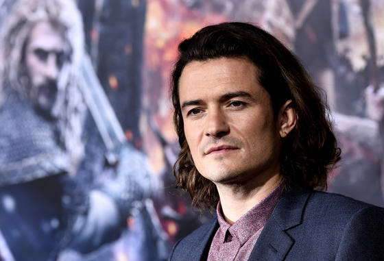 Orlando Bloom dating the girl with the dragon tattoo