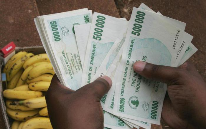 Zimbabwe tires of counting quadrillions and decides to abandon national currency