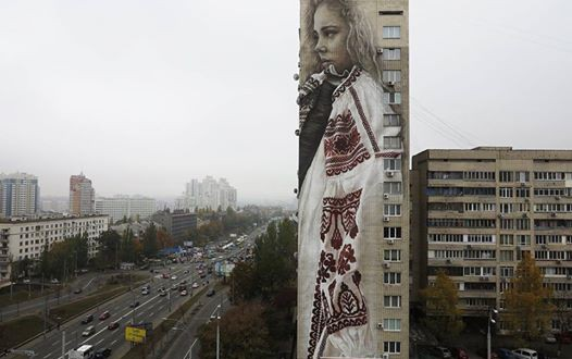 CityArt project: portrait of Ukrainian girl in embroidered shirt on the 18-storey building in Kyiv