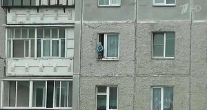 Little boy was taking a walk out of the open window on the 8th floor
