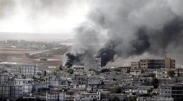 Syrian government army advances into Palmyra amid heavy bombardment
