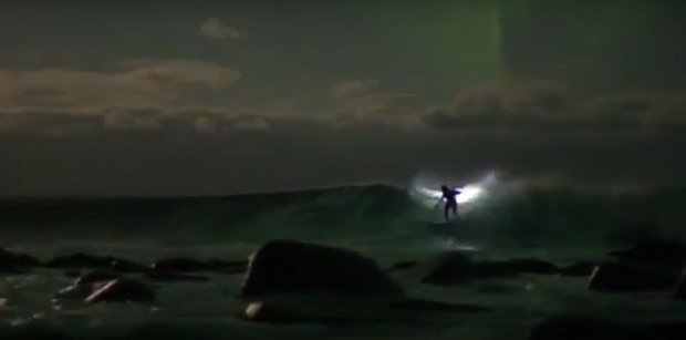 Australian surfing champion rides waves under the magical Northern Lights