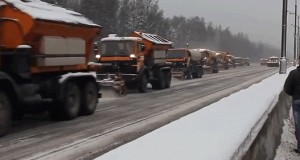 Watch this never-ending parade of trucks clearing snowy roads