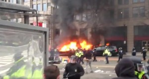 Protesters smash windows, set limousine on fire, pepper sprayed near Trump inauguration
