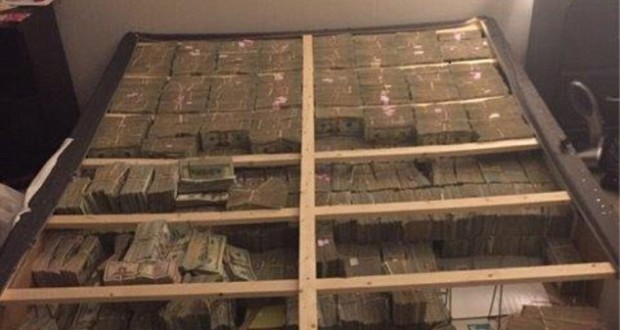 $20million CASH found inside a bed during investigation into pyramid scheme