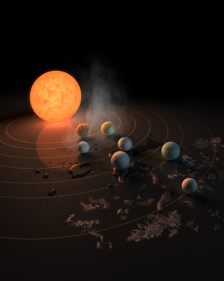 The TRAPPIST-1 star, an ultra-cool dwarf, has seven Earth-size planets orbiting it. This artist's concept appeared on the cover of the journal Nature on Feb. 23, 2017. Credits: NASA/JPL-Caltech