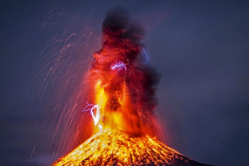 Photographer captures exact moment lightning strikes erupting volcano
