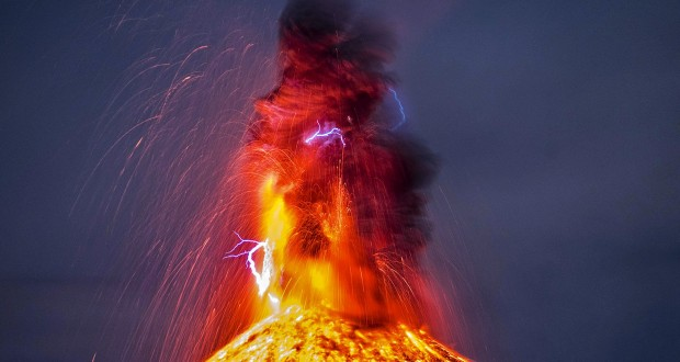 Photographer captures exact moment lightning strikes erupting volcano