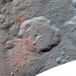 Ceres: This enhanced color composite image, made with data from the framing camera aboard NASA's Dawn spacecraft, shows the area around Ernutet Crater. The bright red portions appear redder with respect to the rest of Ceres.