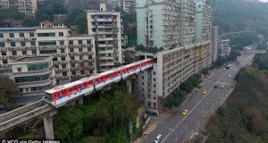 Train goes through the centre of a 19-storey block of flats in China's 'Mountain City'