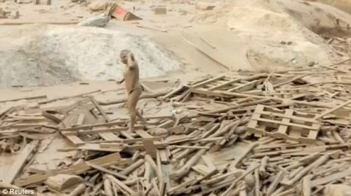 Watch a young woman fighting to escape being swept away in Peru mudslide