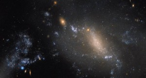 Hubble Spots Two Interacting Galaxies Defying Cosmic Convention
