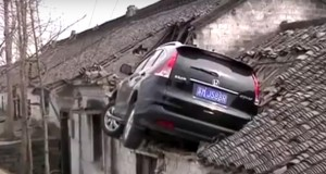 Watch a car crash into roof after driver accidentally steps on accelerator