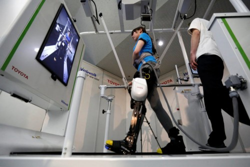 A model demonstrates Toyota Motor Corp's rehabilitation robot Welwalk WW-1000, designed to aid in the rehabilitation of individuals with lower limb paralysis, in Tokyo, on Wednesday. (REUTERS/TORU HANAI)