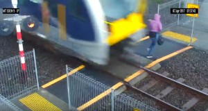 Woman comes just inches from getting struck by a train – video