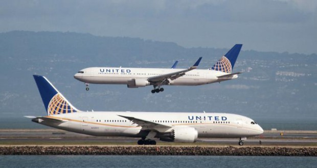 United Airlines under fire after passenger dragged from plane; officer put on leave