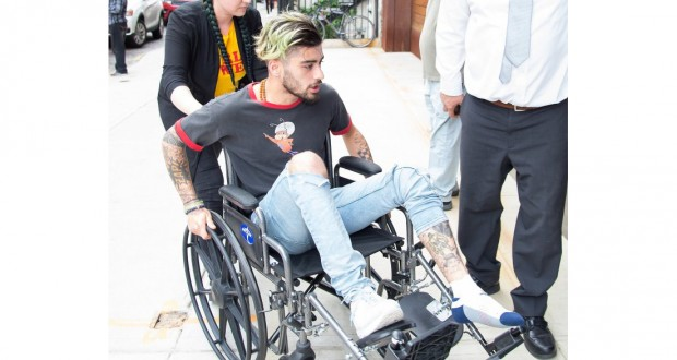Zayn Malik arrives at Gigi Hadid's flat in a wheelchair as mystery injury leaves him unable to walk