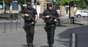 British police name suicide bomber, threat level raised to critical
