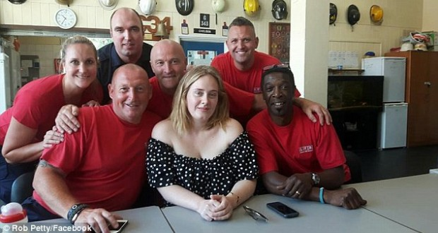 Adele cheers Chelsea firefighters 'with a cup of tea and a cuddle' to thank them for towering inferno heroism