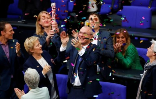 Volker Beck of Germany's environmental party Die Gruenen (The Greens)  celebrates after a session of the lower house of parliament Bundestag voted on legalising same-sex marriage, in Berlin