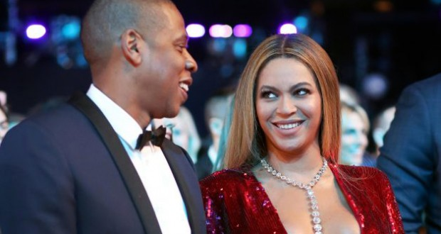 Jay Z grins as he's seen for the first time since Beyonce gave birth to their twins