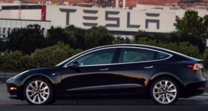 Elon Musk Shows First Tesla Model 3 Production Unit